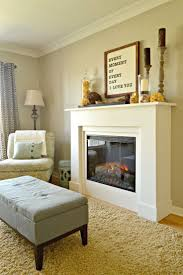 living room sweet white color with modern fireplace for