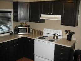 How To Distress White Kitchen Cabinets Transforming Your Kitchen Cabinets And More Makely