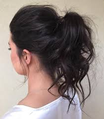 ponytail hair 30 eye catching ways to style curly and wavy ponytails
