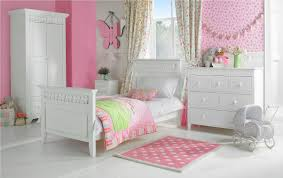 pink toddler room wall with patterned white curtains plus