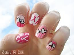 breast cancer awareness month pink nail art with ribbons and bows