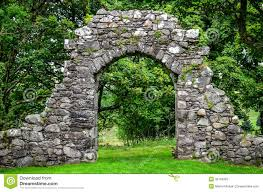 old stone entrance wall in green garden stock photo image 39104923