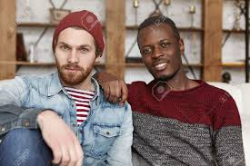 Interacial Lesbians - homosexual love and relationships concept interracial gay couple