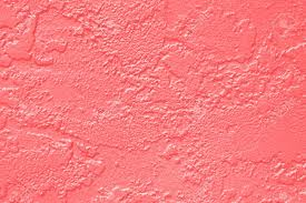 abstract coral pink or peach and salmon color paint wall texture