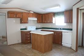 our 40 backsplash using vinyl flooring re fabbed this mobile home kitchen needed major updating and boy did it get it check