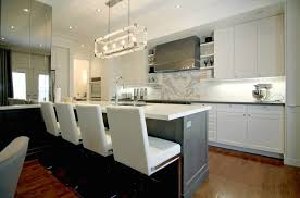 White Kitchen Black Island Two Kitchen Island With White Quartzite Countertops Contemporary