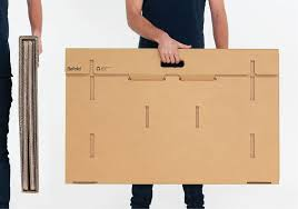 this clever cardboard desk is recyclable portable and lets you