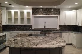 oversized kitchen island white tiger granite caps the oversized kitchen island emrichpro
