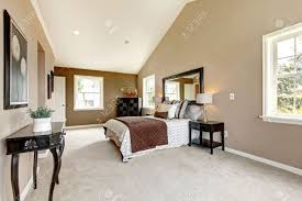 large classic luxury bedroom with brown and white and beige carpet