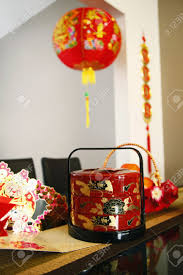 New Year Table Decorations by Chinese New Year Decorations And Cards On Glass Table Stock Photo