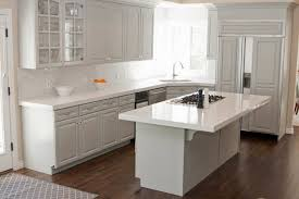 granite countertop dark and light kitchen cabinets rock tile