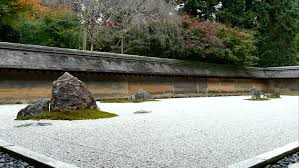 details of the beautiful rock garden at ryoan ji temple kyoto