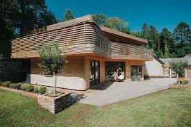 houde home construction furniture designer builds himself a curvy wooden dream home curbed