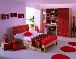romantic couple bedroom design with red love cushions and white