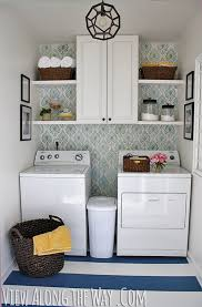 small laundry room storage ideas beautifully organized small laundry rooms the happy housie