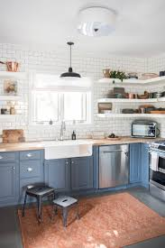 blue kitchen cabinets with wood countertops 75 beautiful kitchen with raised panel cabinets and wood