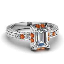 large selection of orange sapphire vintage engagement rings