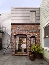 1916 brick boiler room revamped into a tiny guest apartment
