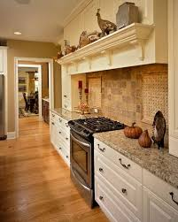 Basket Weave Kitchen Backsplash by Kitchen With Cream Cabinetry And Neutral Tile Backsplash With