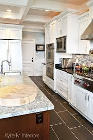 white kitchen cabinets black tile floor chef s white kitchen with marble and granite