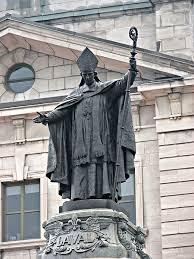 bureau de poste priest statue of bl françois de montmorency laval standing in front of