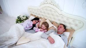 Lovely Couple In Bed Lying In Bedroom Cute Family Sleeping Together Lying In The Bed Stock Footage