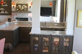 great room bar with columns and glass display cabinets and