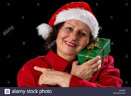 what to get an elderly woman for christmas happy elderly woman with a santa claus hat and a coat she is