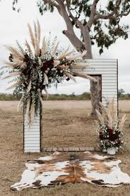 wedding arbor used iron wedding arch with plumes of pas grass and burgundy flowers