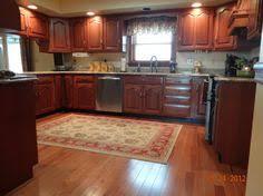 Hardwood Floor Kitchen Hardwood Floors In Kitchen With Oak Cabinets Looking For Tips