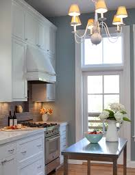 white kitchens stainless steel island gray subway tile
