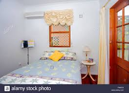 small cozy bedroom with a double bed with a pastel colored sheets