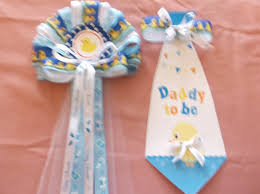 blue mommy and daddy baby shower corsage with yellow duck by