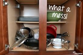 how to organize pots and pans in a cupboard products to organize pots and pans the diy playbook