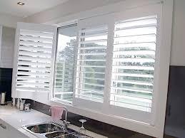 kitchen window shutters interior wood plantation shutters for kitchen strangetowne decorate ideas