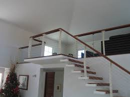 white interior cable railing on cantilever stairs contemporary