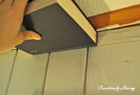 wood paneling makeover faux molding and painting for wood paneling under 30 cents ft