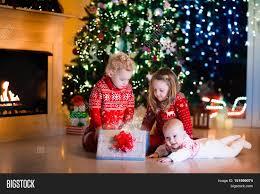 family on christmas eve fireplace image u0026 photo bigstock