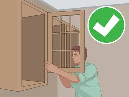 how to fix kitchen base cabinets to wall how to hang wall cabinets 15 steps with pictures wikihow