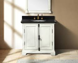 White Vanities Bathroom Black Glossy Top Of White Wooden Vanity And Round White Sink On