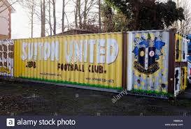 old shipping containers at sutton united fc ground in gander green