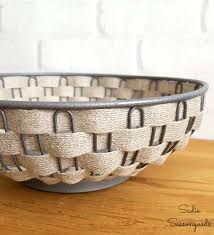 weaving farmhouse style burlap ribbon in a vintage silver bread basket