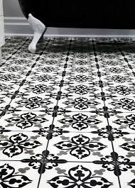 gray and black mosaic fleur de lis tiles transitional bathroom