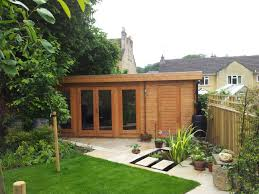 this versatile log cabin incorporates a garden room with an
