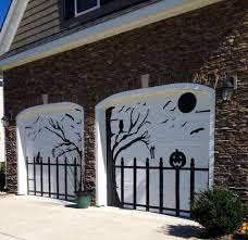 halloween garage door decorated using black contact paper with