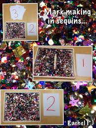 christmas activities mark making sequins and eyfs