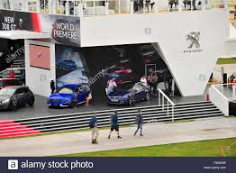 mr peugeot people pass the peugeot stand at the goodwood festival of speed in