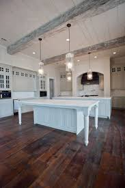 living room shiplap paneling and wood flooring for country