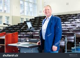college professor giving lecture standing desk stock photo
