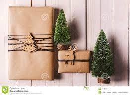 christmas handcraft gift boxes on wood background stock photo